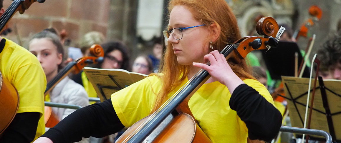 Girl playing an instrument at a performance