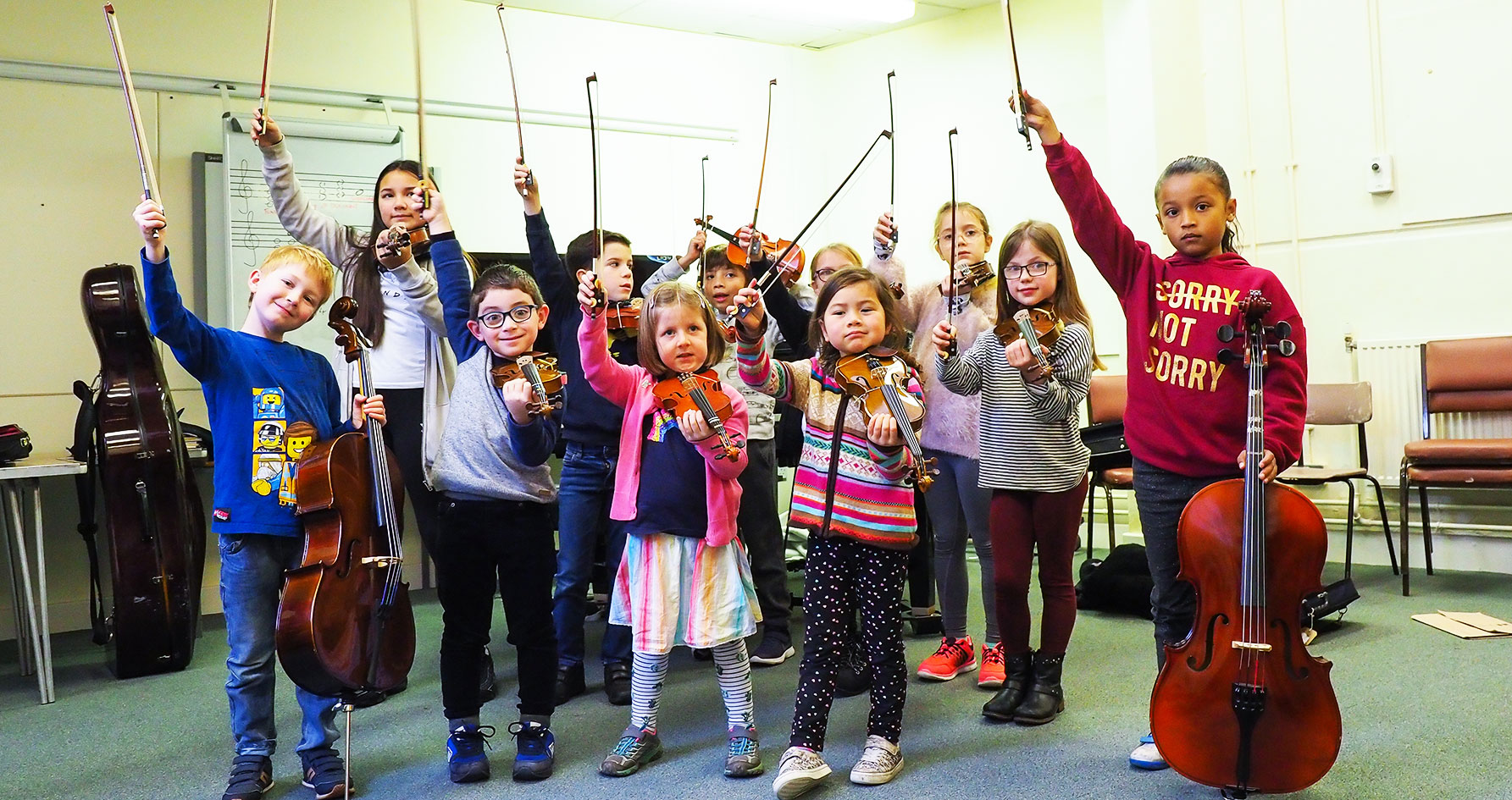 A group of children at a music course